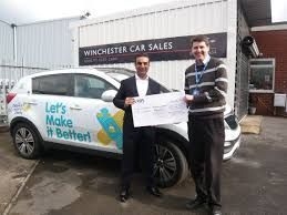Local car dealership donates £2,000 to Children's Hospital Charity